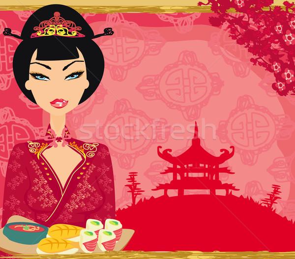 Traditional japanese pretty girl enjoy sushi.  Stock photo © JackyBrown