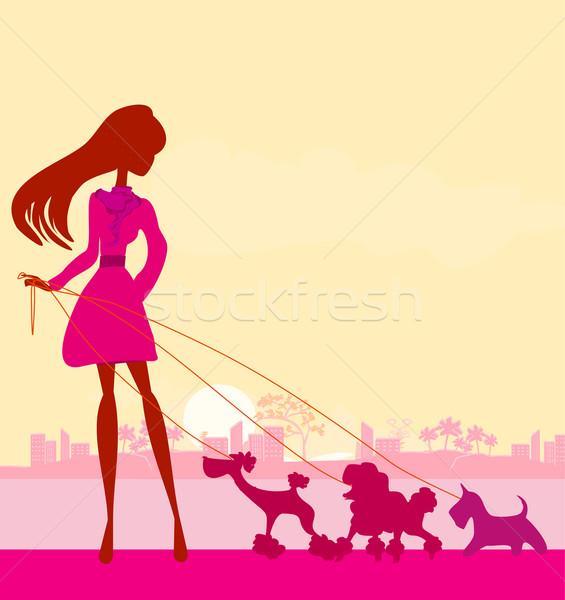 довольно девушки ходьбе собаки женщину Sexy Сток-фото © JackyBrown