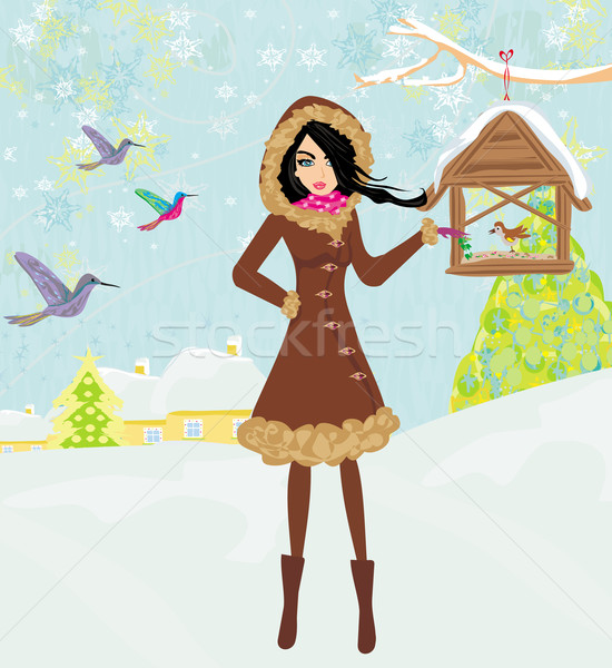 girl feeds the birds in winter  Stock photo © JackyBrown