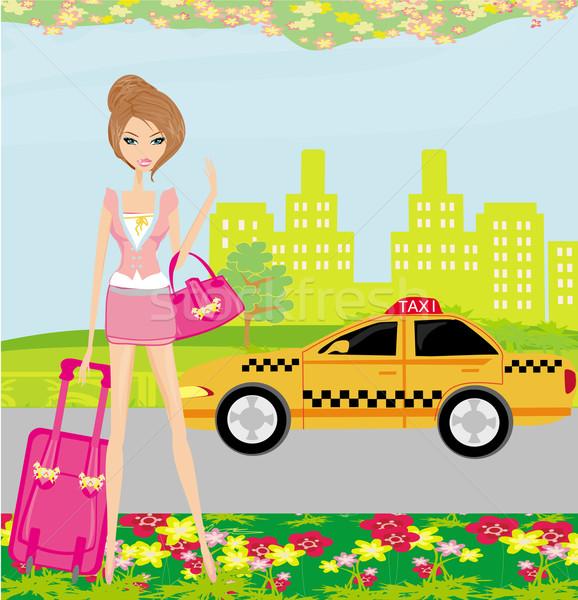 Elegante mujer espera taxi nina ciudad Foto stock © JackyBrown