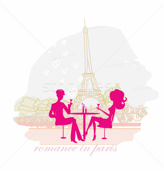 Young couple flirt and drink champagne in Paris  Stock photo © JackyBrown