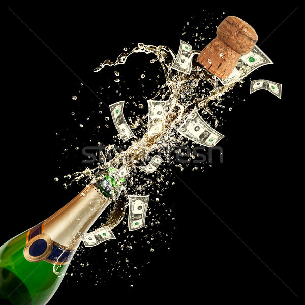 Celebration event with concept of dollar bank-notes splashing out of bottle. Isolated on black backg Stock photo © Jag_cz