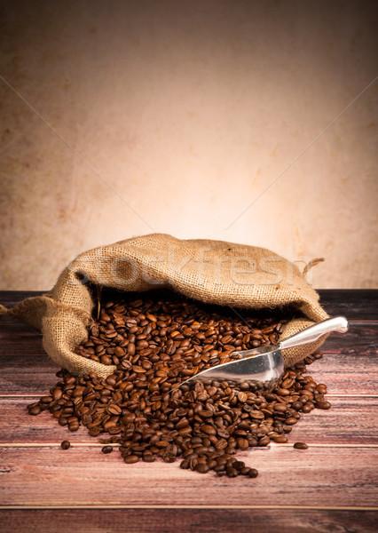 Grains de café toile de jute sac texture alimentaire café Photo stock © Jag_cz