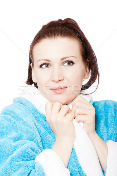 Young woman in blue bathrobe surprised look against white backgr Stock photo © jagston