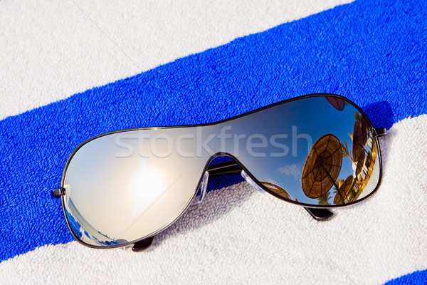Mirrored sunglasses reflecting sun and sunshade Stock photo © jagston