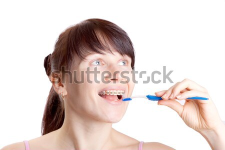 Woman with toothbrush isolated on white Stock photo © jagston
