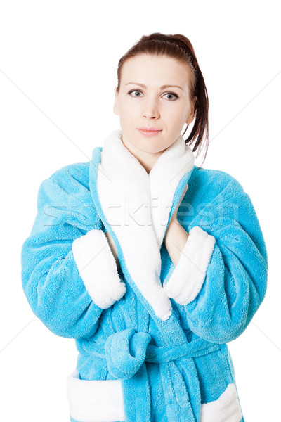 Young attractive woman in sky-blue bathrobe isolated on white Stock photo © jagston