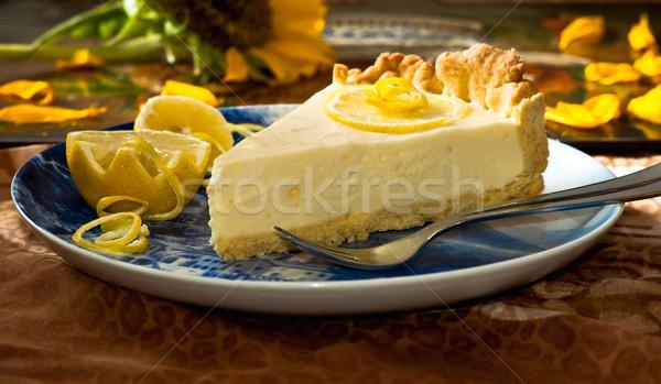Citrom pite tányér gyümölcs kék levelek Stock fotó © jakatics