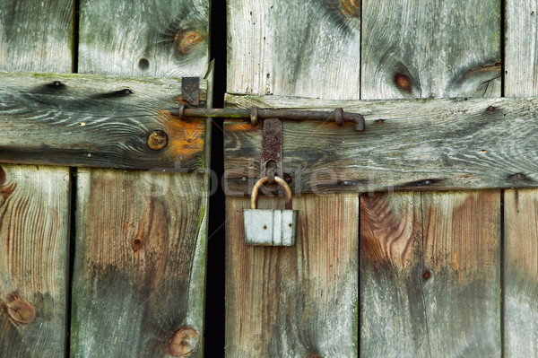 Lock of the old barn door Stock photo © jakatics