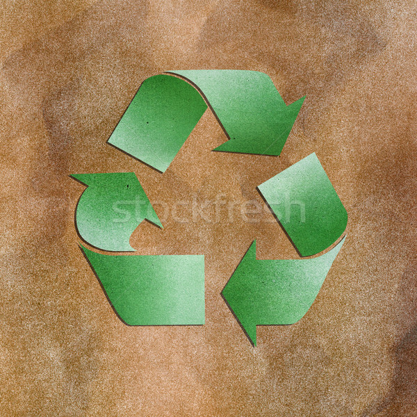 Grunge paper texture green recycle sign on brown background Stock photo © jakgree_inkliang