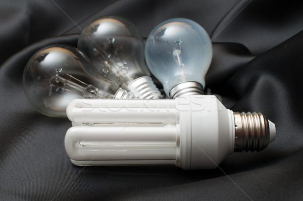Energii oszczędność żarówki trzy wolfram Zdjęcia stock © jamdesign