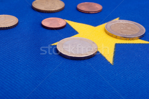 Euro Coins on EU Flag Stock photo © jamdesign