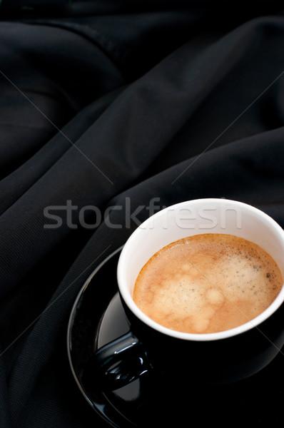 Cup of Coffee on Black Drapery Stock photo © jamdesign