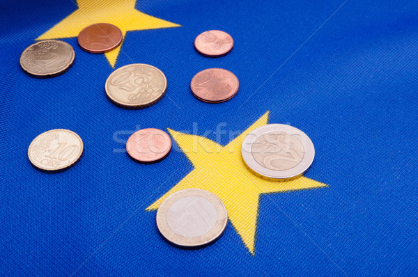 Stock photo: Euro Coins on EU Flag