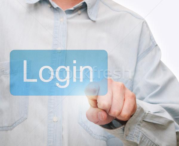 Spingendo login pulsante mano touch screen tecnologia Foto d'archivio © jamdesign