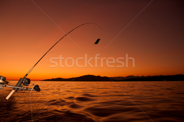 Fishing Road From Boat At Sunset Stock photo © jameswheeler