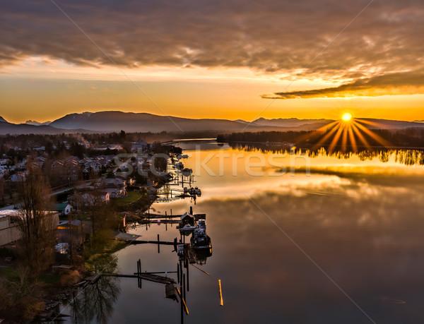 Gündoğumu star nehir tekneler güneş dağlar Stok fotoğraf © jameswheeler