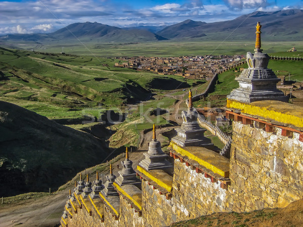 Wall with Stupas and Distant town Stock photo © jameswheeler