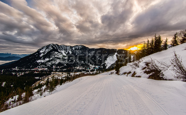 Ski Run at Sunset with Dramatic Clouds Stock photo © jameswheeler