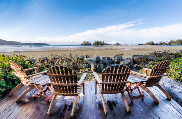 Four Chairs on Deck Overlooking Beach Stock photo © jameswheeler