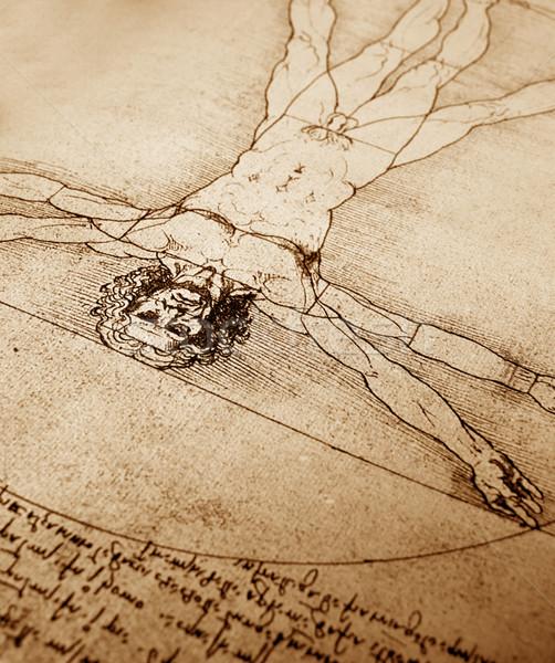 Photo of the Vitruvian Man by Leonardo Da Vinci from 1492 on textured background. Stock photo © janaka