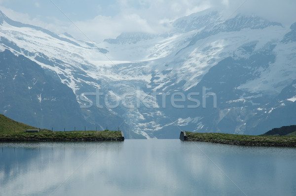 Lac alpes Suisse eau nuages Rock Photo stock © janhetman