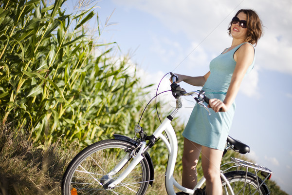 Young woman riding bike, summer free time spending Stock photo © JanPietruszka