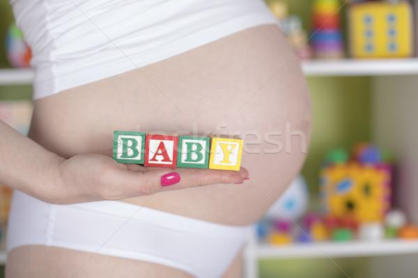 Foto stock: Brinquedo · de · madeira · bebê · cartas · gravidez · mulher