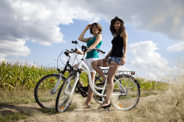 Girls on bike tour, enjoying Stock photo © JanPietruszka