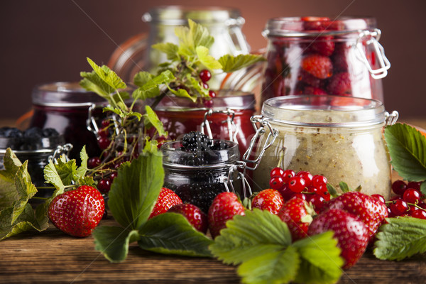 Glass of mixed berry jam with strawberries, bilberries, red curr Stock photo © JanPietruszka