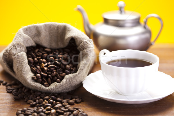 Coffee over dark roasted coffee beans Stock photo © JanPietruszka