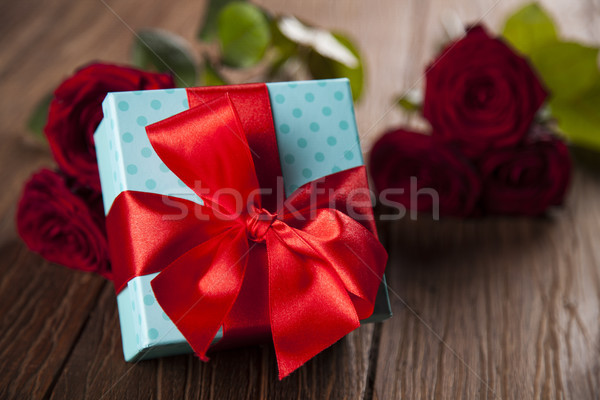 Red roses and gift box, love background  Stock photo © JanPietruszka