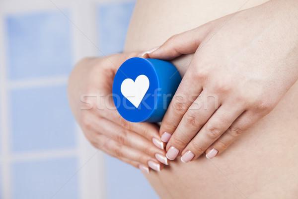 Pregnant woman loving heart her baby Stock photo © JanPietruszka