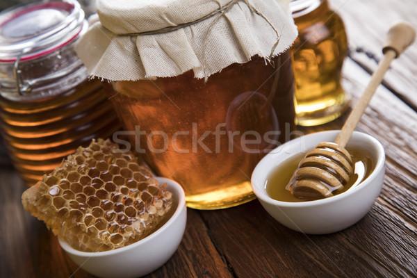 Dolce miele pettine vetro jar completo Foto d'archivio © JanPietruszka