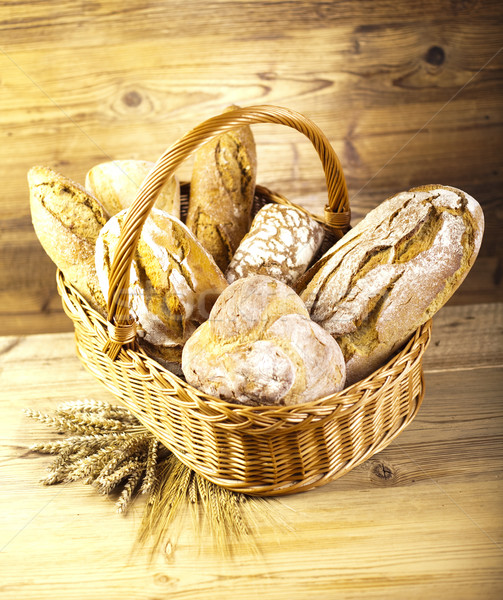 Baked bread in basket, natural colorful tone Stock photo © JanPietruszka