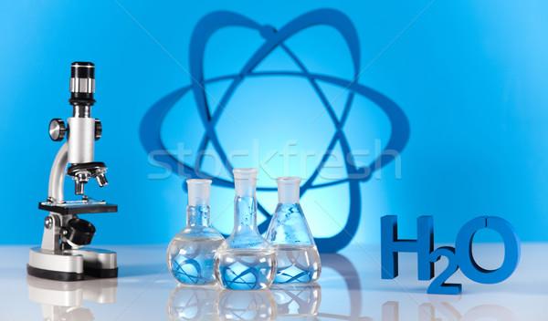 Atom cząsteczki model laboratorium wyroby szklane wody Zdjęcia stock © JanPietruszka