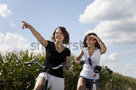 Kadın bisiklet yaz serbest zaman kız yol Stok fotoğraf © JanPietruszka
