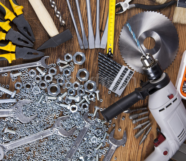 Set of different tools on wooden background Stock photo © JanPietruszka