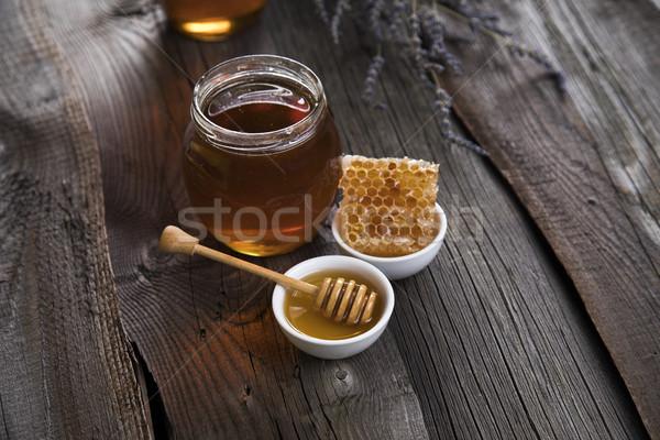 Dolce miele pettine jar a nido d'ape sfondo Foto d'archivio © JanPietruszka