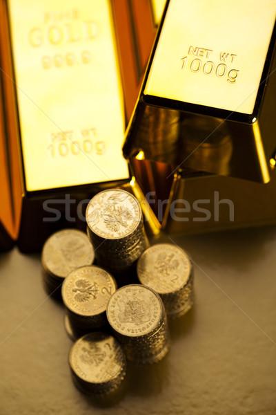 Gold bar and coins Stock photo © JanPietruszka