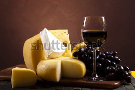 Cheese and wine, saturated ambient rural theme Stock photo © JanPietruszka