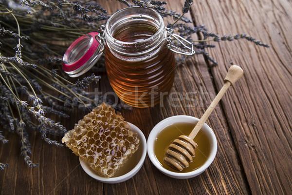 Sweet honey in the comb, glass jar Stock photo © JanPietruszka