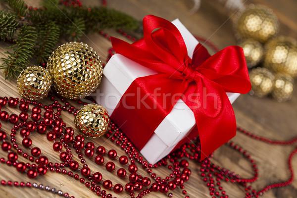 Beautiful gift box with red ribbon on Christmas background Stock photo © JanPietruszka