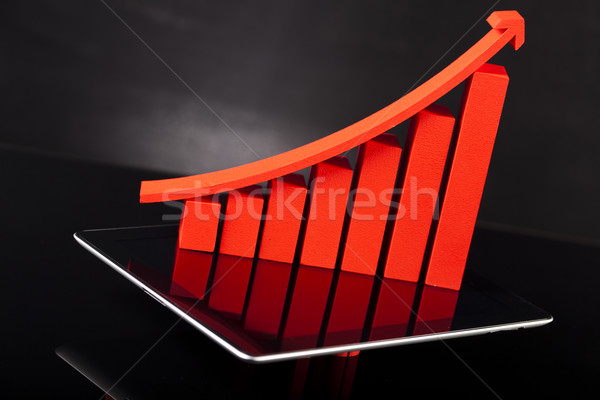 Computer tablet with financial graph  Stock photo © JanPietruszka