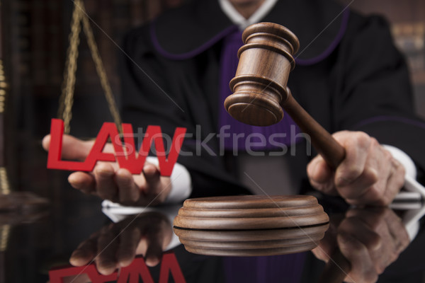 Judge, male judge in a courtroom striking the gavel Stock photo © JanPietruszka