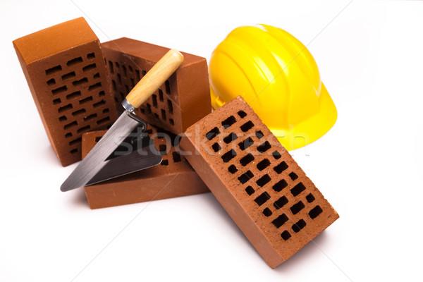Hard hat with bricks and trowel Stock photo © JanPietruszka