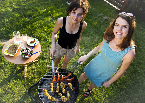 Two girls on grill, natural colorful tone Stock photo © JanPietruszka