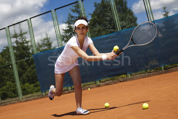 Woman playing tennis in summer Stock photo © JanPietruszka