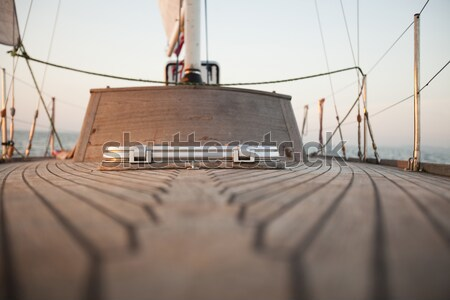 Large winch with line wrapped around and set sail in background Stock photo © JanPietruszka