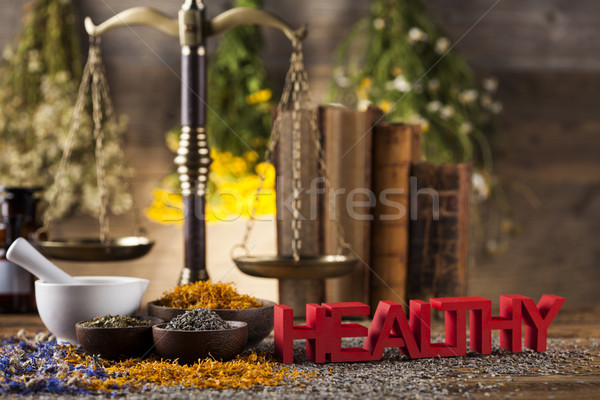 Herbal medicine on wooden desk background Stock photo © JanPietruszka